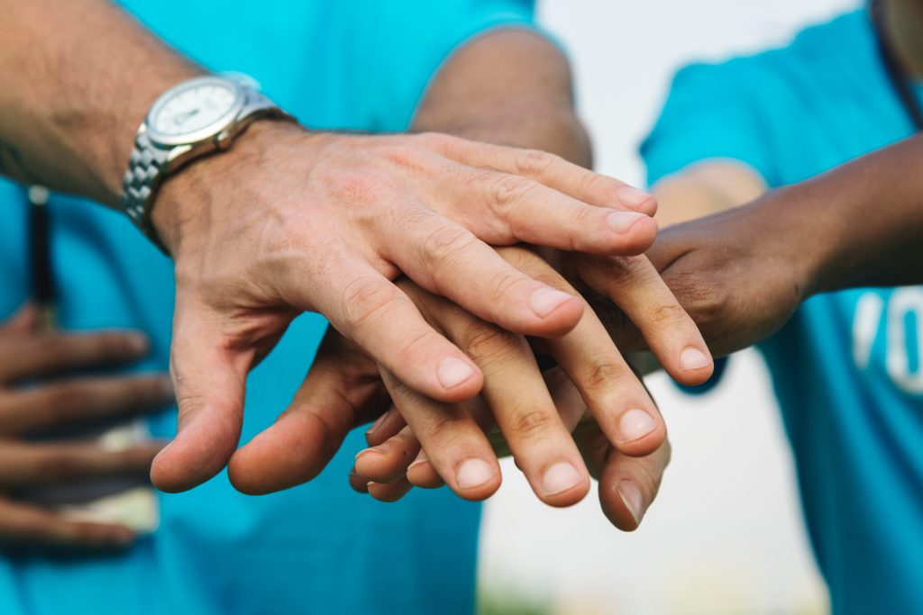 Hands Stacked On Top Of Each Other